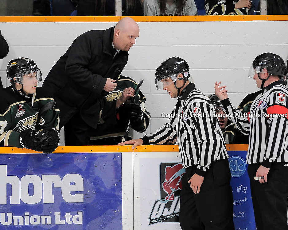 TRENTON, ON - Mar 17, 2015 : Ontario Junior Hockey League game action between the Trenton Golden Hawks and the Cobourg Cougars. Game three of the best of seven semi-final series, Cobourg Cougars Head Coach discusses a call with OHA Referee<br /> (Photo by Amy Deroche/ OJHL Images)