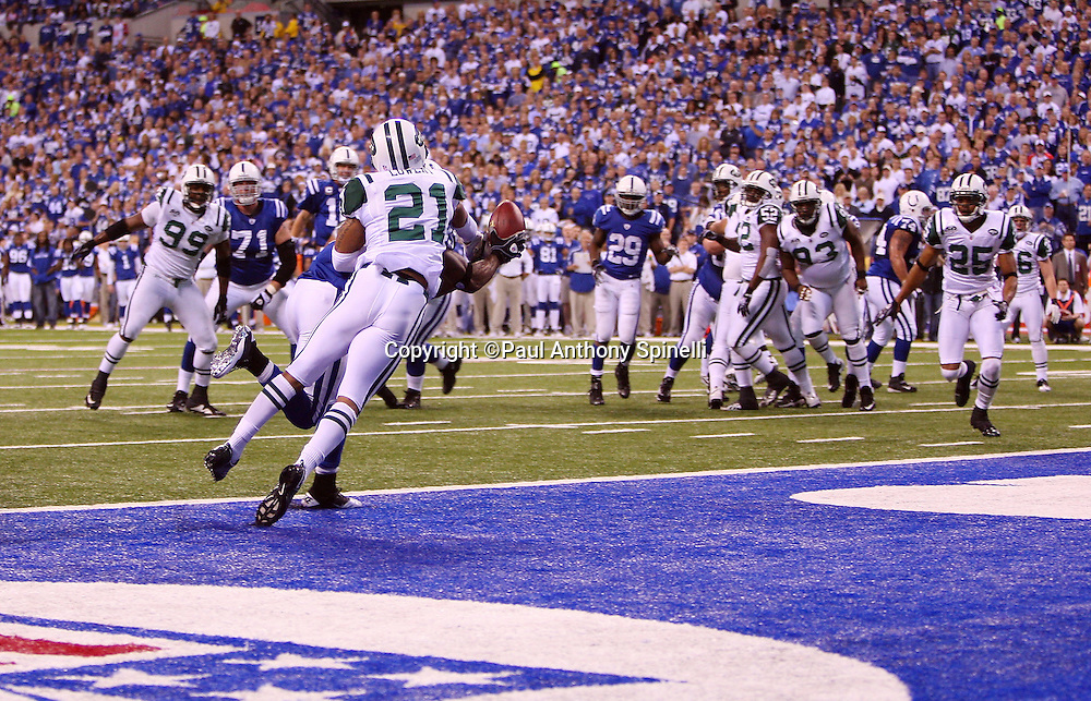 New York Jets cornerback Dwight Lowery (21) breaks up an end zone pass intended for Indianapolis Colts wide receiver Pierre Garcon (85) during the AFC Championship football game against the Indianapolis Colts, January 24, 2010 in Indianapolis, Indiana. The Colts won the game 30-17. ©Paul Anthony Spinelli
