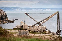 Disused crane at a Portland stone sea quarry, Isle of Portland, Dorset, England, UK.