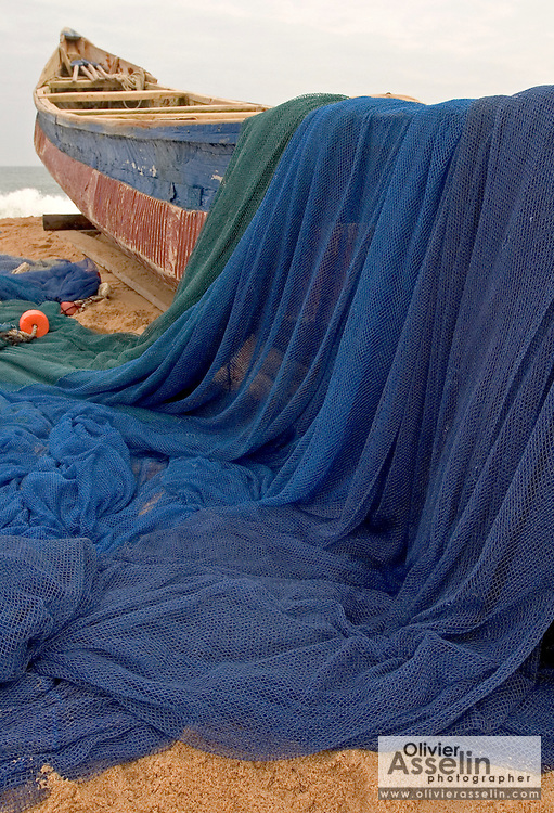 Fishing nets and boat on the beach at Aflao, Volta Region, Eastern Ghana