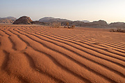 Desert scenery. Red sand plateau at the foot of the Edom mountains, Jordan
