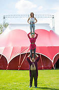UNITED KINGDOM, London: 3 May 2018 Members of Britains leading circus company Lost in Translation performs in front of their pop up circus tent in Shillington Park in Wandsworth. The performance marks the start of the Wandsworth Arts Fringe and the opening of Battersea Circus Gardens which runs from May 4 - May 20 2018. Rick Findler / Story Picture Agency
