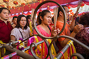 31 JANUARY 2014 - BANGKOK, THAILAND:   People pray at Wat Mangkon Kamalawat during Lunar New Year festivities, also know as Tet and Chinese New Year, in Bangkok. This year is the Year of the Horse. Ethnic Chinese make up about 14% of Thailand and Chinese holidays are widely celebrated in Thailand.     PHOTO BY JACK KURTZ
