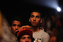 Young men listening to the speakers introducing Aboul Fotouh.