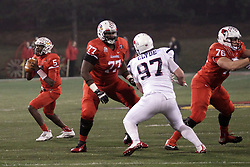 11 December 2015:  Tre Roberson(5) readies to throw given time by Kyle Avaloy(77) who is holding off Andrew Clyde. NCAA FCS Quarter Final Football Playoff game between Richmond Spiders and Illinois State Redbirds at Hancock Stadium in Normal IL (Photo by Alan Look)