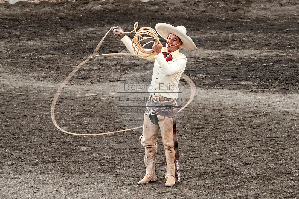 Juan Franco practices his rope skills during the family Charreria practice session in the Jalisco Highlands town of Capilla de Guadalupe, Mexico. The Franco family has dominated Mexican rodeo for 40-years and has won three national championships, five second places and five third places.