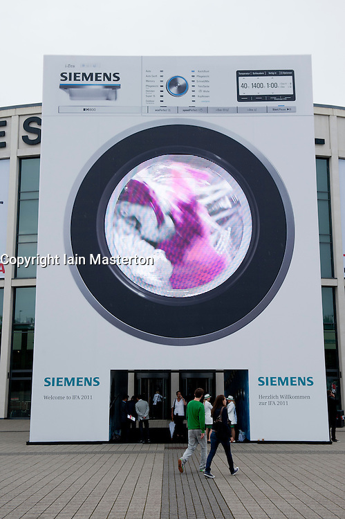 Large washing machine billboard at IFA consumer electronics trade fair in Berlin Germany 2011