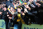Oxford fans celebrate going 2-1 up during the The FA Cup third round match between Oxford United and Swansea City at the Kassam Stadium, Oxford, England on 10 January 2016. Photo by Jemma Phillips.