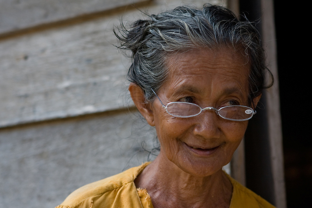 An elderly woman sports new reading glasses in Central Sulawesi