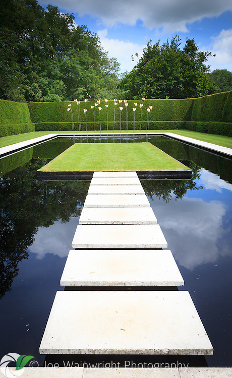 The Water Garden at Kiftsgate Court, Gloucestershire was created on the site of an old tennis court.  Water drips into the pool from 24 gilded bronze philodendron leaves mounted on stainless steel stems.
