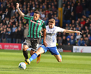 Rochdale Midfielder, Nathaniel Mendez-Laing and Bury Defender Joe Riley battle during the Sky Bet League 1 match between Bury and Rochdale at Gigg Lane, Bury, England on 17 October 2015. Photo by Mark Pollitt.