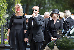© Licensed to London News Pictures. 22/05/2018. London, UK. Family and friends  of television presenter Dale Winton watch as his coffin is carried into Commonwealth Church in Marylebone, London. Dale Winton, who was found dead at his home on April 18, was famous for presenting Supermarket Sweep and National Lottery game show. Photo credit: Peter Macdiarmid/LNP