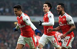 Arsenal's Alexis Sanchez celebrates scoring the opening goal during the Premier League match at the Emirates Stadium, London.