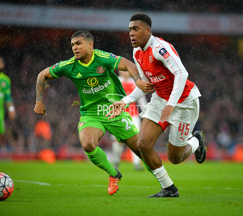 Arsenal Forward Alex Iwobi, Sunderland Defender DeAndre Yedlin during the The FA Cup match between Arsenal and Sunderland at the Emirates Stadium, London, England on 9 January 2016. Photo by Adam Rivers.