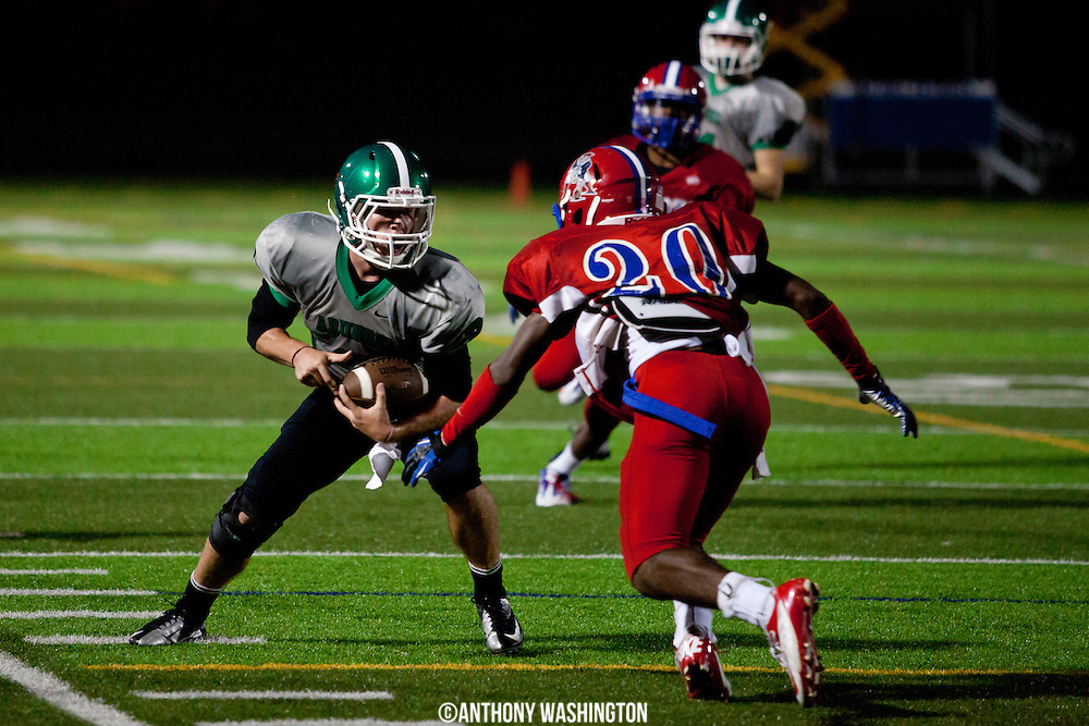 Arundel High School Wide Receiver Tyler Young attempts to make a defender miss during a 4A East game against Old Mill High School on Friday, October 5, 2012 in Severn, MD.