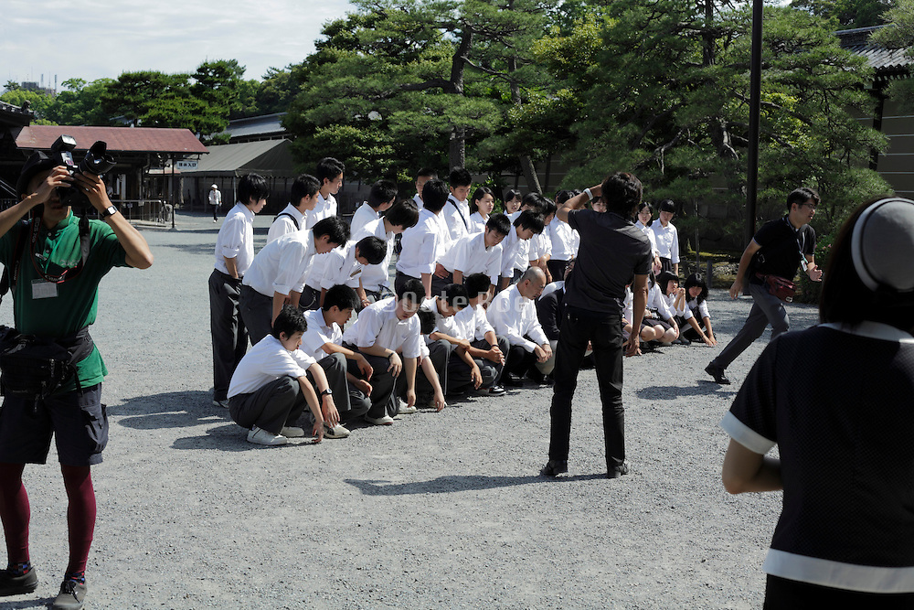 boys only school group getting ready for a photo Kyoto Japan