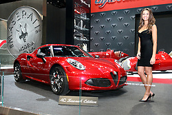 "12 February 2015: Displayed by a female model - 2015 Alfa Romeo 4C: Alfa Romeo likes to call their all-new 2015 4C Coupe, ""The Attainable Supercar."" With groundbreaking Italian design and clever technological solutions, the company can offer the 4C Coupe for a fraction of the price of other exotic supercars. With design nods to history, the 4C and 4C Launch Edition makes reference to the style of the 1967 33 Stradale, and combines Alfa Romeo engineering and Maserati manufacturing into one. Outer body is made of Sheet Molded Compound (SMC) that is 20-percent lighter than steel. The monocoque of the Alfa Romeo 4C – weighing only 236 lbs – is a single carbon fiber body, just like a supercar, in which space is cut out for the driver and a passenger.  With its transverse-mounted mid-engine configuration, the new, direct injection, 237-horsepower 1.75-liter turbocharged four-cylinder engine, entirely made of aluminum, brings extraordinary performance with a peak torque of 258 lb-ft. to the rear wheels. Sole transmission is a six-speed dual-clutch sequential manual. The combination puts the accent on smooth running for the under 2,500-lb. sports car. And, while emitting baritone exhaust sounds, the 4C can dashes from 0-60 mph in 4.1 seconds, and reach a top speed of 160 mph.  A rear storage compartment behind the seating accommodates small parcels. The 2015 Alfa Romeo 4C will have a limited production run, including the 500 Launch Editions scheduled for U.S. buyers only.<br /> <br /> First staged in 1901, the Chicago Auto Show is the largest auto show in North America and has been held more times than any other auto exposition on the continent. The 2015 show marks the 107th edition of the Chicago Auto Show. It has been  presented by the Chicago Automobile Trade Association (CATA) since 1935.  It is held at McCormick Place, Chicago Illinois"