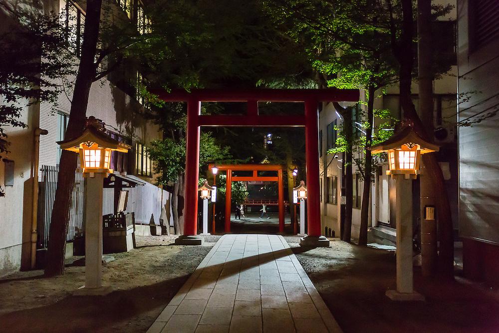 Red tori gates mark the entrance to Hanazono Shrine in Shinjuku