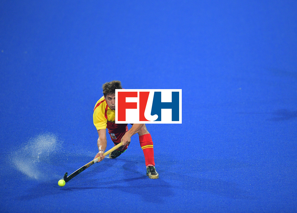 Spain's Josep Romeu hits the ball during the men's field hockey Spain vs Brazil match of the Rio 2016 Olympics Games at the Olympic Hockey Centre in Rio de Janeiro on August, 6 2016. / AFP / Carl DE SOUZA        (Photo credit should read CARL DE SOUZA/AFP/Getty Images)