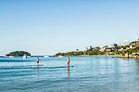 Stand up paddle na Praia de Jurerê. Florianópolis, Santa Catarina, Brasil. / Stand up paddle at Jurere Beach. Florianopolis, Santa Catarina, Brazil.