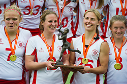 30-06-2012 LACROSSE: EUROPEES KAMPIOENSCHAP ENGELAND - WALES: AMSTERDAM<br /> (L-R) Team England with gold medals and trophy, 7 Annie Hiliier, 2 captain Katy Bennett, 25 Lucy Lynch ENG. England wins the gold medal match against Wales<br /> ©2012-FotoHoogendoorn.nl / Peter Schalk
