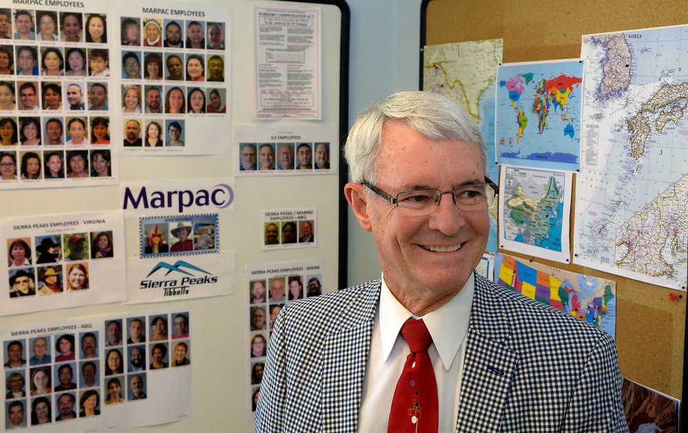 gbs062017c/BUSINESS -- John Rockwell, President of Marpac Medical Devieces and Sierra Peaks, in a break room with photos of employees and world maps of where they come from on Tuesday, June 20, 2017. (Greg Sorber/Albuquerque Journal)