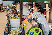 02 MARCH 2014 - MYAWADDY, KAYIN, MYANMAR (BURMA):  A sugar cane juice vendor in the market area of Mywaddy, Myanmar. Myawaddy is separated from the Thai border town of Mae Sot by the Moei River. Myawaddy is the most important trading point between Myanmar and Thailand.     PHOTO BY JACK KURTZ