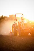 Farming in Oregon and Washington.  A tractor at sunrise on a farm.