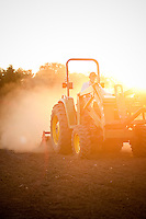 Farming in Oregon and Washington.  A tractor at sunrise on a farm.