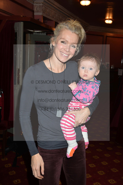 NELL MCANDREW and her daughter ANYA HARDCASTLE at a VIP evening for the pantomime Aladdin at The New Wimbledon Theatre, The Broadway, Wimbledon, London SW19 on 9th December 2013.