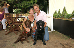 BEN FOGLE and his fiancee MARINA HUNT with their dogs Inca and Maggie at the Macmillan Cancer Support Dog Day held in the gardens of the Royal Hospital, Chelsea, London on 4th July 2006.<br /><br />NON EXCLUSIVE - WORLD RIGHTS