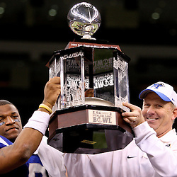 Dec 20, 2009; New Orleans, LA, USA; Middle Tennessee State Blue Raiders head coach Rick Stockstill (right) and quarterback Dwight Dasher (left) holds up the trophy following a win in the 2009 New Orleans Bowl at the Louisiana Superdome. Middle Tennessee State defeated Southern Miss 42-32. Mandatory Credit: Derick E. Hingle-US PRESSWIRE