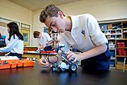 8th grader Saovino Ferraro building his robot in Computer Science Robotics class at Sacred Heart School, Mt. Holly, Dec. 16, 2013.