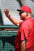 ANAHEIM, CA - APRIL 30:  Mike Scioscia #14 of the Los Angeles Angels of Anaheim waves and calls out during batting practice before the game against the Cleveland Indians at Angel Stadium on Wednesday, April 30, 2014 in Anaheim, California. The Angels won the game 7-1. (Photo by Paul Spinelli/MLB Photos via Getty Images) *** Local Caption *** Mike Scioscia