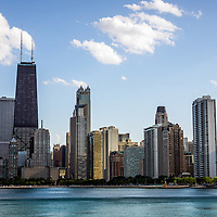 Photo of Chicago skyline Gold Coast area with John Hancock Building and the Lake Michigan lakefront shoreline. The John Hancock Center is one of the world's tallest skyscrapers and is a famous fixture in the Chicago skyline.