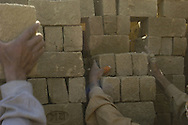 Afghan men work at a brick factory in Kabul May 6, 2005. Afghanistan is one of the world's poorest countries and working as a casual labourer is a major source of employment for many Afghans.