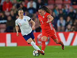 SOUTHAMPTON, ENGLAND - Friday, April 6, 2018: Wales' Natasha Harding and England's Lucia Bronze during the FIFA Women's World Cup 2019 Qualifying Round Group 1 match between England and Wales at St. Mary's Stadium. (Pic by David Rawcliffe/Propaganda)