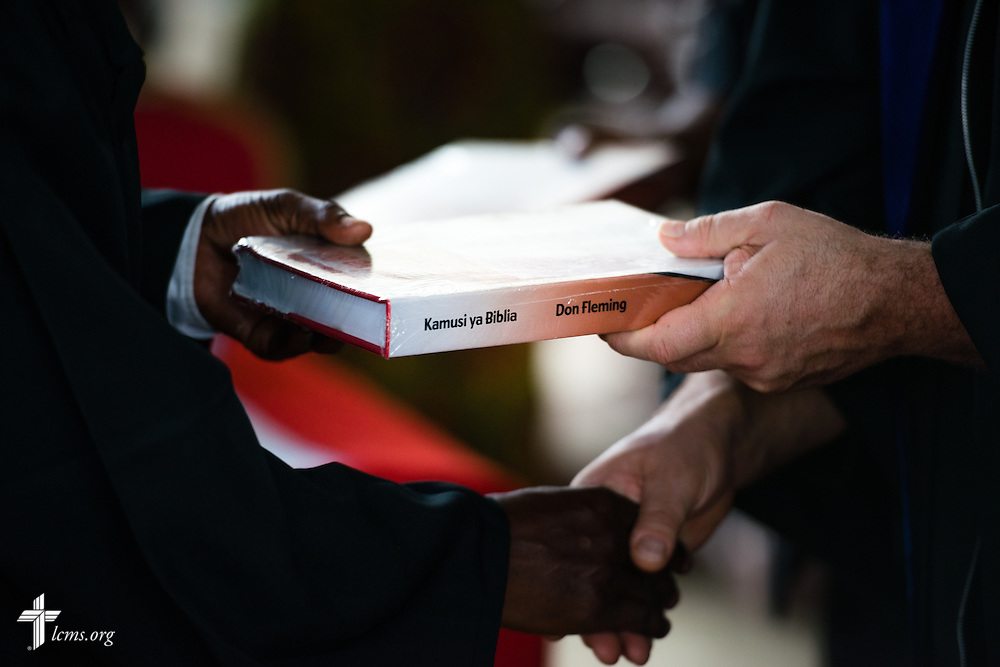 Bible dictionaries are given during the graduation of 21 pastors and seven deaconesses led by Bishop Emmanuel Makala on Saturday, March 14, 2015, at the Evangelical Lutheran Church in Tanzania – South-East of Lake Victoria Diocese's (ELCT-SELVD) Ebenezer Cathedral in Shinyanga, Tanzania.  LCMS Communications/Erik M. Lunsford