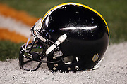 A Pittsburgh Steelers helmet lies on the field turf before the NFL AFC Wild Card playoff football game against the Cincinnati Bengals on Saturday, Jan. 9, 2016 in Cincinnati. The Steelers won the game 18-16. (©Paul Anthony Spinelli)
