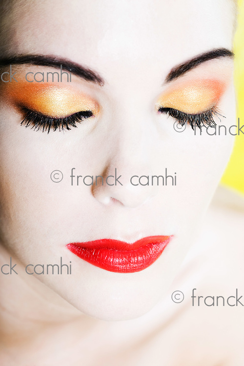 beautiful caucasian woman beauty eyes closed with colorful make up  portrait studio