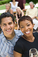 Couple holding wine outdoors, portrait