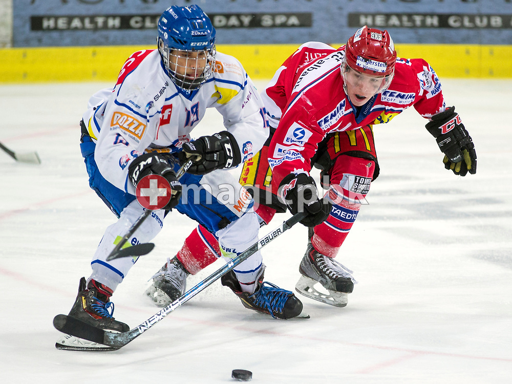 (L-R) ZSC Lions forward Stefan Diezi fights for the puck against Rapperswil-Jona Lakers forward Nicola Meier during the fifth Elite B Playoff Final ice hockey game between Rapperswil-Jona Lakers and ZSC Lions held at the SGKB Arena in Rapperswil, Switzerland, Sunday, Mar. 19, 2017. (Photo by Patrick B. Kraemer / MAGICPBK)