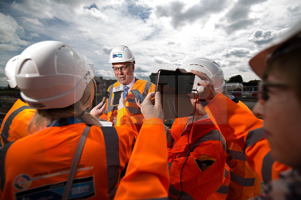 © Licensed to London News Pictures . 05/08/2016 . Cheshire , UK . CHRIS GRAYLING talking to media during a visit to the A6 relief road construction site , near to Manchester Airport , on his first visit to the North West since he was appointed Transport Secretary . Photo credit : Joel Goodman/LNP