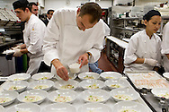 Chef Daniel Humm, owner of Eleven Madison Park in New York City, prepares a meal at the Campton Place Restaurant in San Francisco.