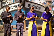 Gospel singers peform at the Victoria and Alfred Waterfront in Cape Town for visitors and tourists, South Africa.