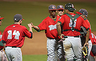 TinCaps pitcher Alexis Lara (16) fist bumps third baseman Justin Baum (14) in game three of the Midwest League Championship at Community Field in Burlington, Iowa on September 17, 2009.