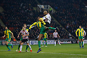 Sheffield United forward David McGoldrick (17)  beats West Bromwich Albion defender Tosin Adarabioyo (24) in the air during the EFL Sky Bet Championship match between Sheffield United and West Bromwich Albion at Bramall Lane, Sheffield, England on 14 December 2018.