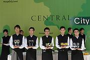 Waiters at press conference in Hong Kong