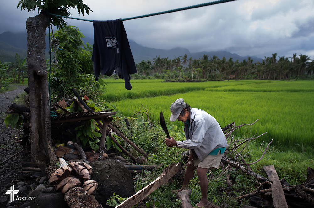 A man chops debris leftover from Typhoon Haiyan in Mahayag, Leyte Province, Philippines, on Saturday, March 15, 2014. LCMS Communications/Erik M. Lunsford