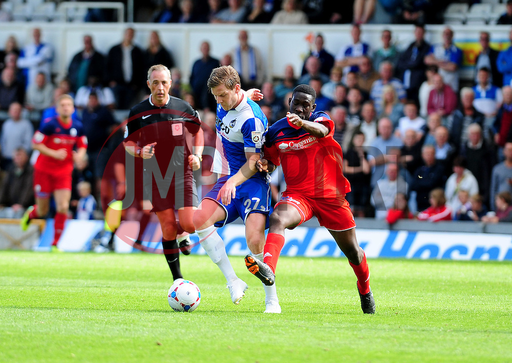 Bristol Rovers' Adam Cunnington is challenged by AFC Telford's Godfrey Poku - Photo mandatory by-line: Neil Brookman - Mobile: 07966 386802 23/08/2014 - SPORT - FOOTBALL - Bristol - Memorial Stadium - Bristol Rovers v AFC Telford - Vanarama Football Conference